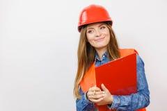 妇女工程师在盔甲的建筑建造者 库存图片