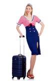 妇女带着手提箱的旅行乘务员 免版税图库摄影