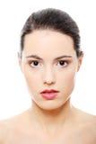 妇女年轻人的美丽的接近的表面纵向 免版税库存图片