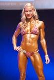 妇女形象模型显示她的最好在阶段的冠军 免版税库存图片
