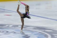 妇女形象溜冰者执行夫人自由滑冰的节目在冰星国际花样滑冰竞争 免版税库存图片