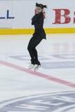 妇女形象溜冰者执行夫人自由滑冰的节目在冰星国际花样滑冰竞争 库存照片
