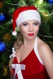 妇女性感的圣诞老人 库存照片