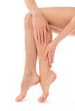 妇女感人的手和腿 库存照片