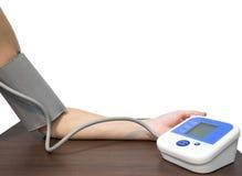 妇女手和测量的血压 库存图片