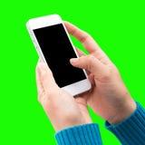 妇女手藏品和使用机动性,手机,有屏幕的巧妙的电话 免版税库存图片