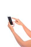 妇女手藏品和接触在智能手机有黑屏iso的 免版税图库摄影
