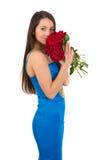 妇女拿着一朵红色玫瑰 免版税库存图片