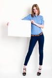 妇女提供一个大空插件 免版税库存图片