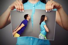 妇女撕裂的照片 免版税库存照片
