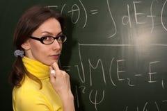 妇女教授学员粉笔板 库存图片
