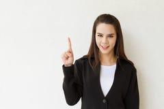 妇女显示1或一手指手势的商业主管 免版税库存图片