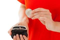妇女有一枚硬币在手 库存图片
