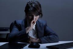 妇女有消沉在工作 免版税库存照片