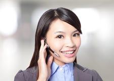 妇女有耳机的客户支持运算符 免版税图库摄影