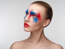 妇女构成秀丽蓝色红色眼睛颜色 免版税库存照片