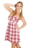 妇女格子花呢披肩礼服猪尾手头发 免版税图库摄影