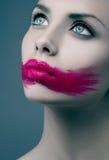 妇女桃红色嘴唇 免版税库存图片