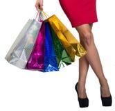 妇女横渡了拿着袋子的腿和手 库存照片