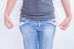 妇女没有金钱在口袋 免版税图库摄影