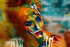 妇女油漆杰作 免版税库存图片