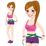 妇女测量的腰部 库存图片