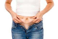 妇女测量的身体 免版税库存照片