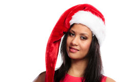 妇女混合的族种圣诞老人帮手帽子画象 库存图片