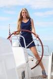 妇女游艇年轻人 免版税库存照片