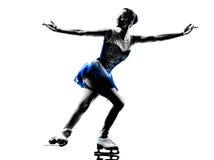 妇女溜冰者滑冰的剪影 免版税库存图片