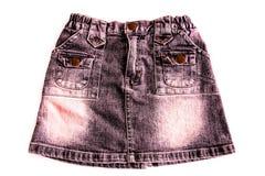 妇女牛仔布裙子 免版税库存照片
