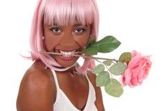 妇女特写镜头有桃红色玫瑰的在嘴 库存照片