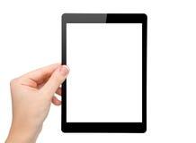 妇女现有量暂挂与查出的屏幕的一种微型片剂 免版税库存照片