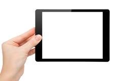 妇女现有量暂挂与查出的屏幕的一种微型片剂 免版税图库摄影