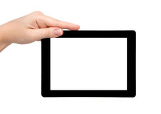 妇女现有量暂挂有查出的屏幕的一种片剂 免版税库存照片