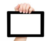 妇女现有量暂挂有查出的屏幕的一种片剂 免版税库存图片