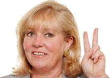 妇女现有量符号 免版税库存图片