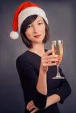 妇女用饮料香槟 免版税库存图片