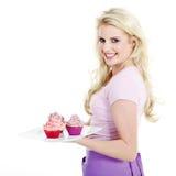 妇女用鲜美杯形蛋糕 库存图片