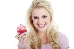 妇女用鲜美杯形蛋糕 免版税库存图片