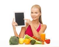 妇女用水果、蔬菜和片剂个人计算机 库存图片