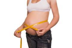 妇女由磁带评定一个胃 免版税库存图片