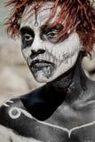 妇女画象有红色头发的和组成万圣夜样式 免版税库存图片