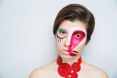 妇女疯狂的艺术组成嘴唇眼睛 免版税库存照片