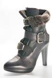 妇女的与高跟鞋的冬天起动 图库摄影