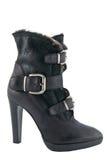 妇女的与高跟鞋的冬天起动 免版税库存图片
