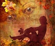 妇女的剪影明亮的秋天背景的 免版税库存图片