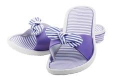 妇女的海滩鞋子,被隔绝 库存照片