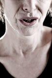 妇女的接近的嘴前辈 图库摄影