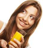 妇女的接近的饮用的汁液桔子 库存图片